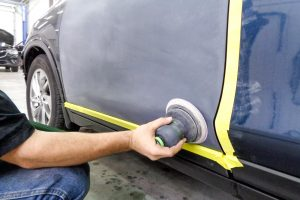 Sanding a car door for painting